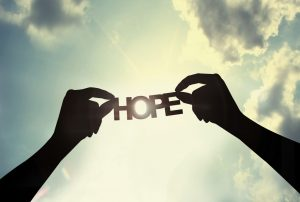 picture of the word hope held by two hands